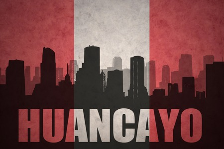 peruvian: abstract silhouette of the city with text Huancayo at the vintage peruvian flag background