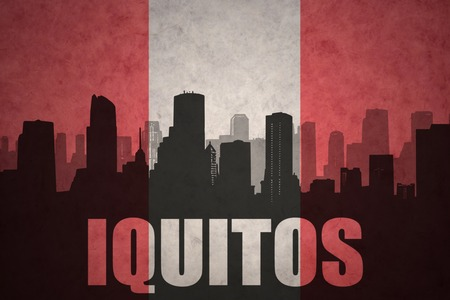 peruvian: abstract silhouette of the city with text Iquitos at the vintage peruvian flag background Stock Photo