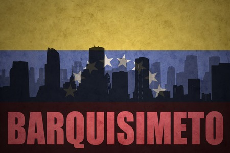venezuelan flag: abstract silhouette of the city with text Barquisimeto at the vintage venezuelan flag background Stock Photo
