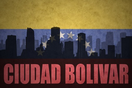 venezuelan flag: abstract silhouette of the city with text Ciudad Bolivar at the vintage venezuelan flag background