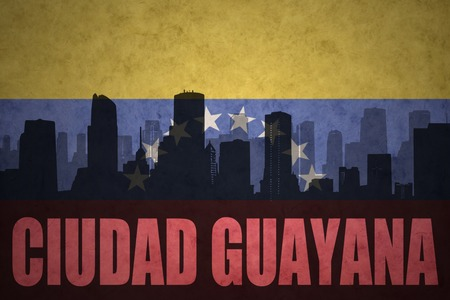 venezuelan flag: abstract silhouette of the city with text Ciudad Guayana at the vintage venezuelan flag background