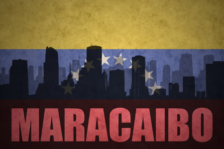 venezuelan flag: abstract silhouette of the city with text Maracaibo at the vintage venezuelan flag background