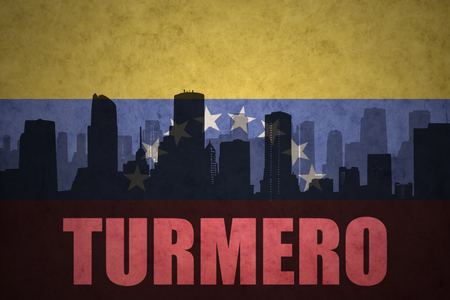 venezuelan flag: abstract silhouette of the city with text Turmero at the vintage venezuelan flag background Stock Photo