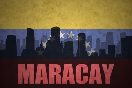 venezuelan flag: abstract silhouette of the city with text Maracay at the vintage venezuelan flag background