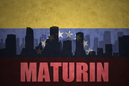 venezuelan flag: abstract silhouette of the city with text Maturin at the vintage venezuelan flag background