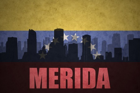 venezuelan flag: abstract silhouette of the city with text Merida at the vintage venezuelan flag background Stock Photo