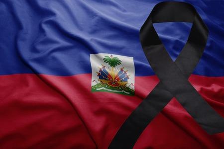 waving national flag of haiti with black mourning ribbon Stock Photo