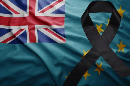 waving national flag of Tuvalu with black mourning ribbon Stock Photo