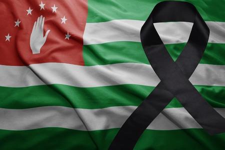 mideast: waving national flag of abkhazia with black mourning ribbon