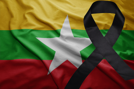 mideast: waving national flag of myanmar with black mourning ribbon