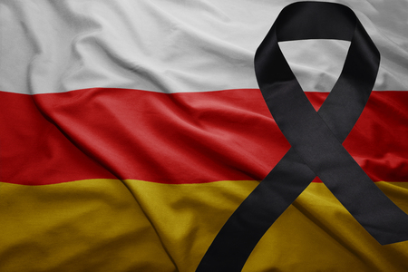 mideast: waving national flag of south ossetia with black mourning ribbon