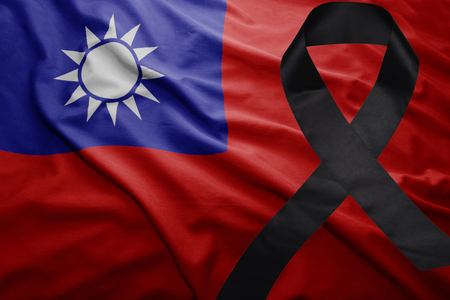 conflictos sociales: waving national flag of taiwan with black mourning ribbon Foto de archivo