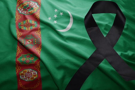 waving national flag of turkmenistan with black mourning ribbon Stock Photo
