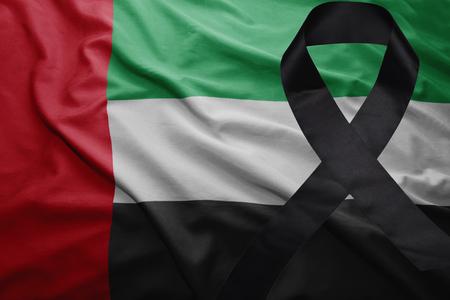 waving national flag of united arab emirates with black mourning ribbon Stock Photo