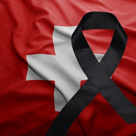 conflictos sociales: waving national flag of switzerland with black mourning ribbon