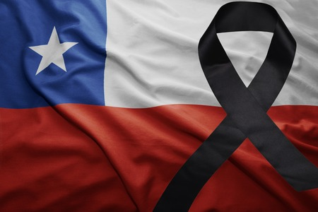 waving national flag of chile with black mourning ribbon Stock Photo