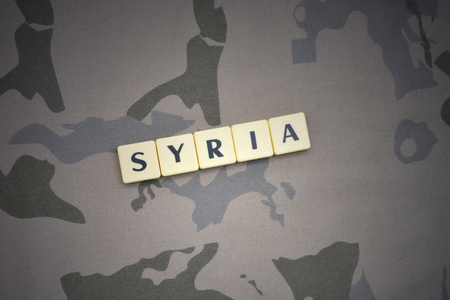 syria peace: letters with text syria on the khaki background. military concept Stock Photo
