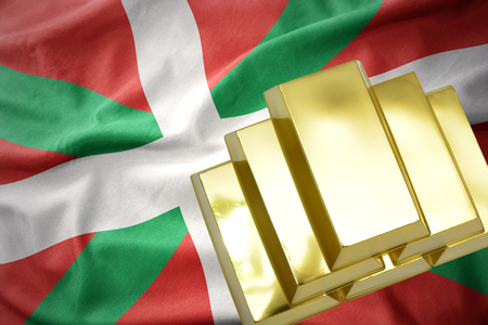 concern: gold reserves. shining golden bullions on the basque country flag background