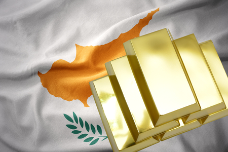 concern: gold reserves. shining golden bullions on the cyprus flag background