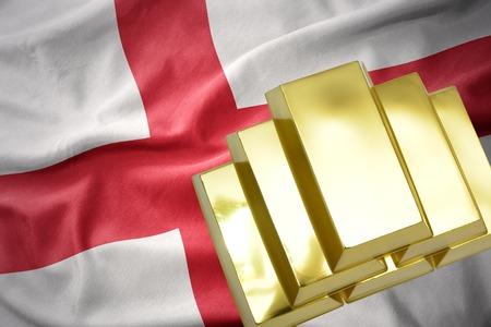 reserve: gold reserves. shining golden bullions on the england flag background Stock Photo