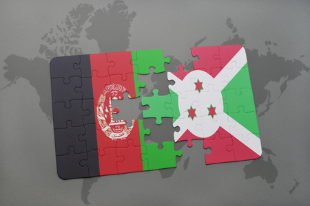 bujumbura: puzzle with the national flag of afghanistan and burundi on a world map background. 3D illustration