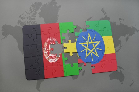middle east conflict: puzzle with the national flag of afghanistan and ethiopia on a world map background. 3D illustration