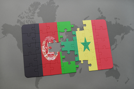 dakar: puzzle with the national flag of afghanistan and senegal on a world map background. 3D illustration
