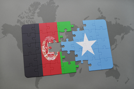 puzzle with the national flag of afghanistan and somalia on a world map background. 3D illustration