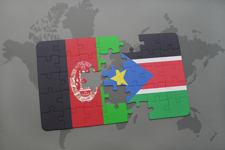 south sudan: puzzle with the national flag of afghanistan and south sudan on a world map background. 3D illustration Stock Photo