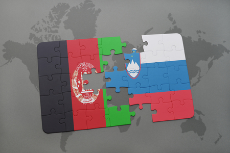 slovenian: puzzle with the national flag of afghanistan and slovenia on a world map background. 3D illustration