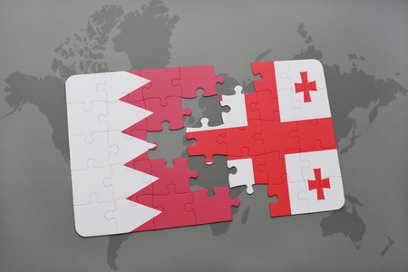 georgian: puzzle with the national flag of bahrain and georgia on a world map background. 3D illustration