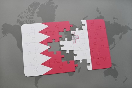 puzzle with the national flag of bahrain and malta on a world map background. 3D illustration