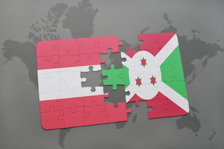 puzzle with the national flag of austria and burundi on a world map background. 3D illustration