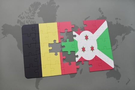 puzzle with the national flag of belgium and burundi on a world map background. 3D illustration