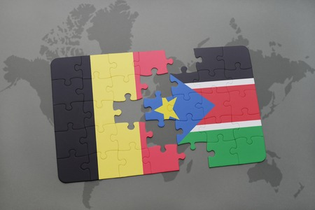 south sudan: puzzle with the national flag of belgium and south sudan on a world map background. 3D illustration