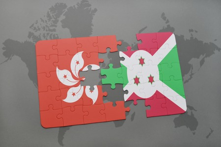 puzzle with the national flag of hong kong and burundi on a world map background. 3D illustration