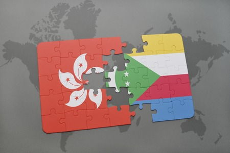 puzzle with the national flag of hong kong and comoros on a world map background. 3D illustration