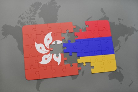 puzzle with the national flag of hong kong and armenia on a world map background. 3D illustration Stock Photo