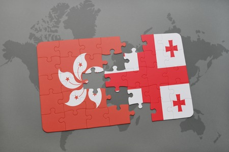puzzle with the national flag of hong kong and georgia on a world map background. 3D illustration