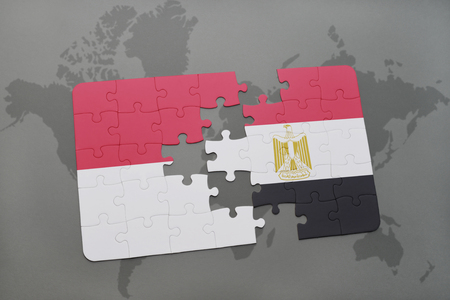 puzzle with the national flag of indonesia and egypt on a world map background. 3D illustration Stock Photo