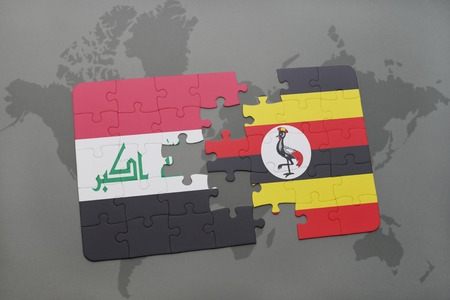 kampala: puzzle with the national flag of iraq and uganda on a world map background. 3D illustration