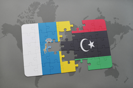 canary islands: puzzle with the national flag of canary islands and libya on a world map background. 3D illustration