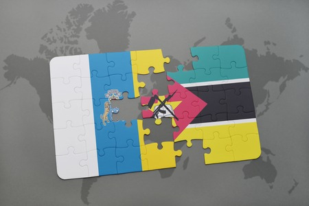 canary islands: puzzle with the national flag of canary islands and mozambique on a world map background. 3D illustration