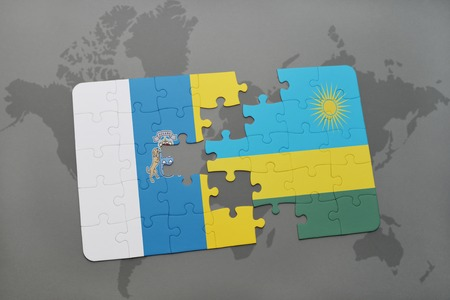 kigali: puzzle with the national flag of canary islands and rwanda on a world map background. 3D illustration Stock Photo