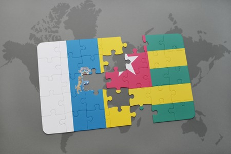 canary islands: puzzle with the national flag of canary islands and togo on a world map background. 3D illustration