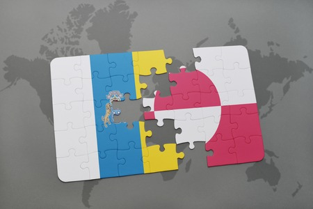 puzzle with the national flag of canary islands and greenland on a world map background. 3D illustration