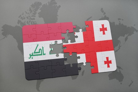 georgian: puzzle with the national flag of iraq and georgia on a world map background. 3D illustration