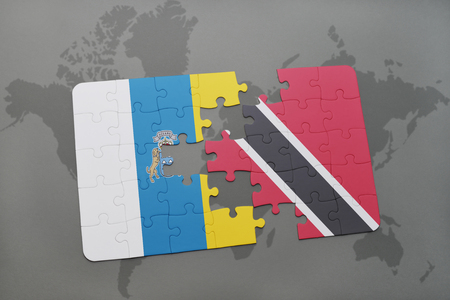 canary islands: puzzle with the national flag of canary islands and trinidad and tobago on a world map background. 3D illustration