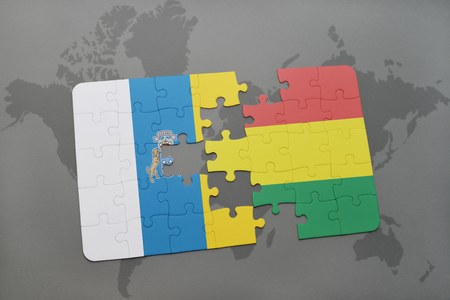 puzzle with the national flag of canary islands and bolivia on a world map background. 3D illustration Stock Photo