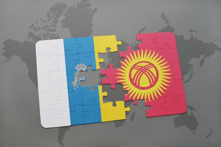 canary islands: puzzle with the national flag of canary islands and kyrgyzstan on a world map background. 3D illustration Stock Photo
